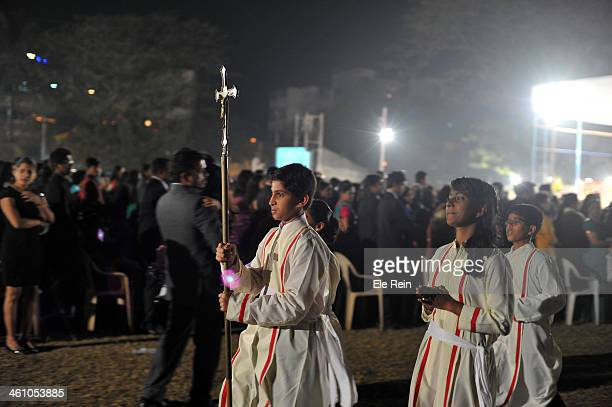 Young catholic boy holds the alter at midnight mass at Immaculate Conception Church,at mount Poinsur, Mumbai suburb India.Historically this church...