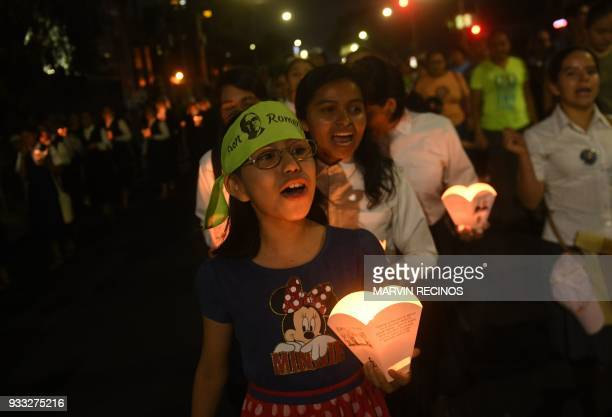 Young Catholic faithfuls take part in vigil commemorating the 38th anniversary of the assassination of Salvadorean Archbishop Oscar Arnulfo Romero...