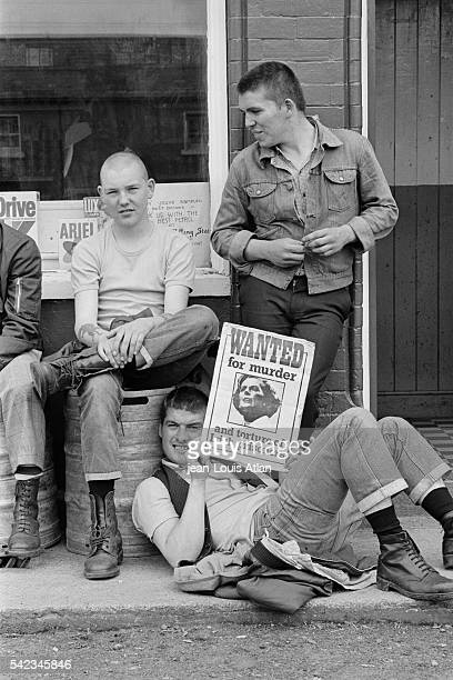 Young Catholic militants in the streets of Belfast holding a 'Wanted' poster of Margaret Thatcher