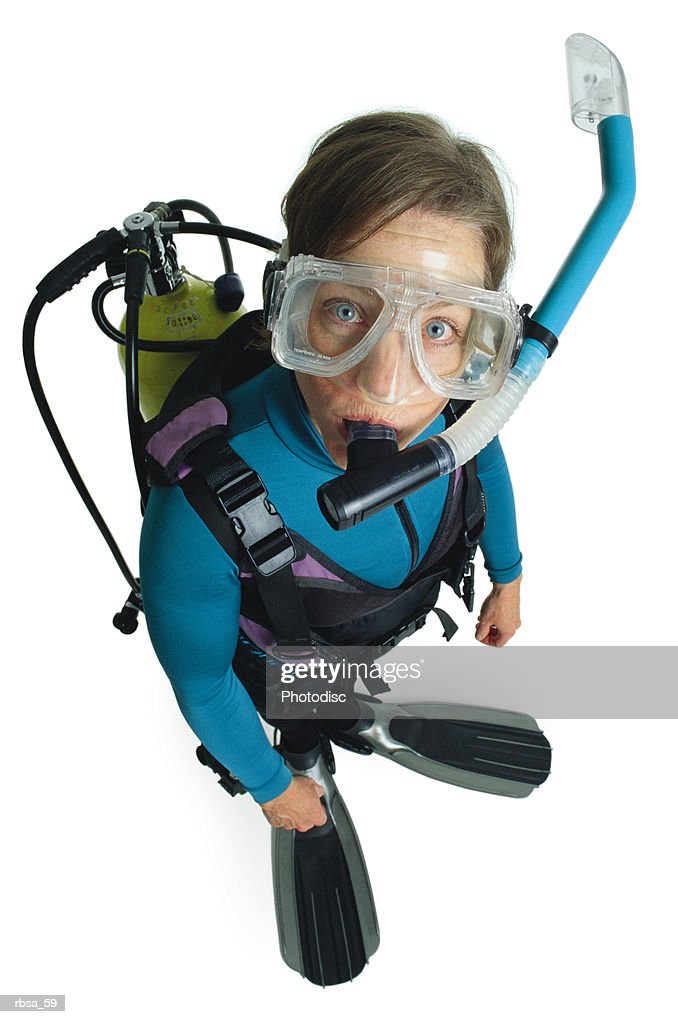 young caucasian adult blue eyed male in blue wet scuba gear diving mask snorkel comical expression : Foto de stock