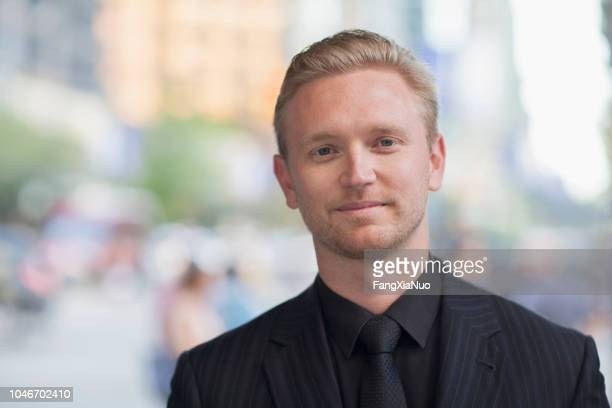 young caucasian businessman street portrait - well dressed stock pictures, royalty-free photos & images