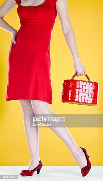 young caucasian girl legs detail in red