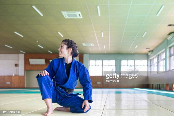 young caucasian judo athelete in dojo - judo stock pictures, royalty-free photos & images