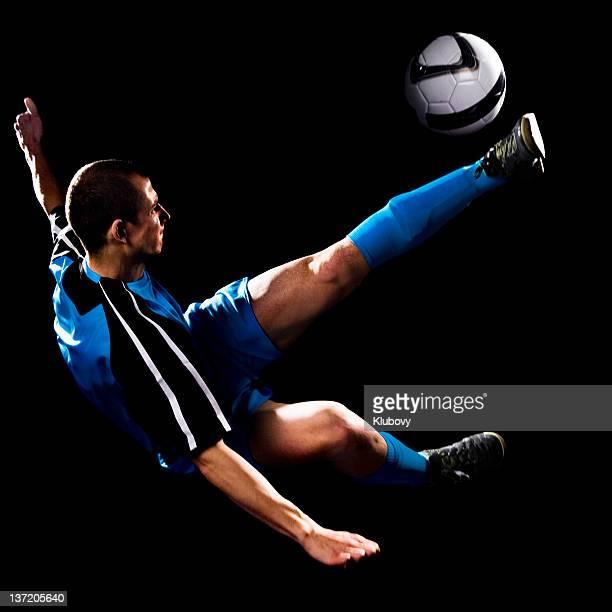 young caucasian male making soccer bicycle kick - anfallsspelare fotboll bildbanksfoton och bilder