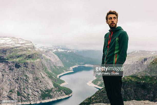 Young Caucasian man on Trolltunga in Norway