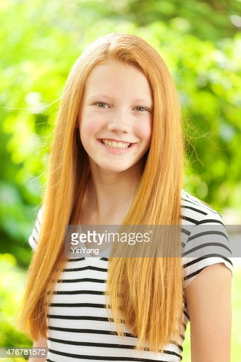Teenage Caucasian Girl15 Years Old Sitting Outdoors Stock: Young Caucasian Teen Girl With Reddish Blond Hair Portrait