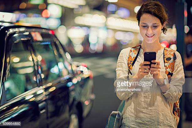 Young Caucasian tourist girl is texting
