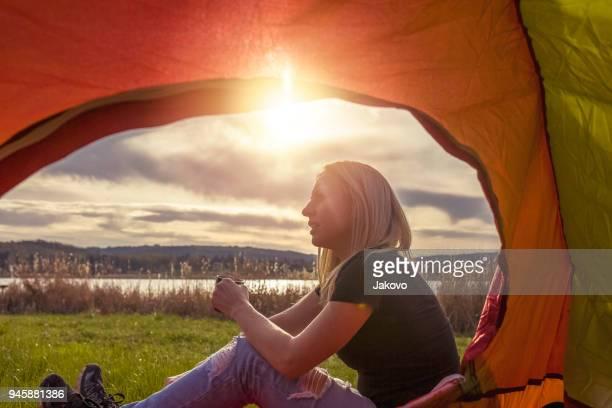 Young caucasian woman enjoying by the lake