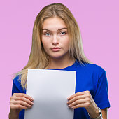 young caucasian woman holding blank paper