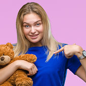 young caucasian woman holding cute teddy
