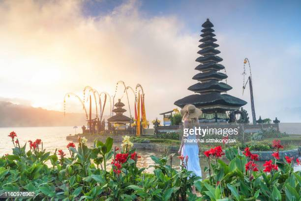 young caucasian woman walking in balinese temple, indonesia - lake bratan area stock pictures, royalty-free photos & images
