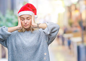 young caucasian woman wearing christmas hat
