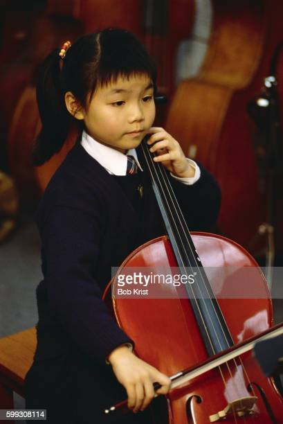 Young Cellist Practicing