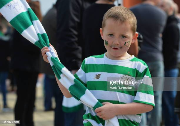 A young Celtic fan enjoys the atmosphere prior to the Scottish Premier League match between Celtic and Aberdeen at Celtic Park on May 13 2018 in...