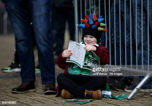 Young Celtic fan Rory Durrant aged 5 from East Lothian reads his match programme before attending his very first football match the Ladbrokes...