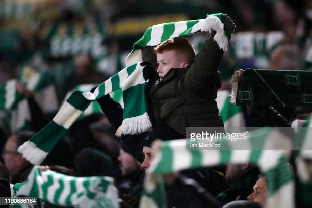 Young Celtic fan shows his support for his team during the UEFA Europa League group E match between Celtic FC and Stade Rennes at Celtic Park on...