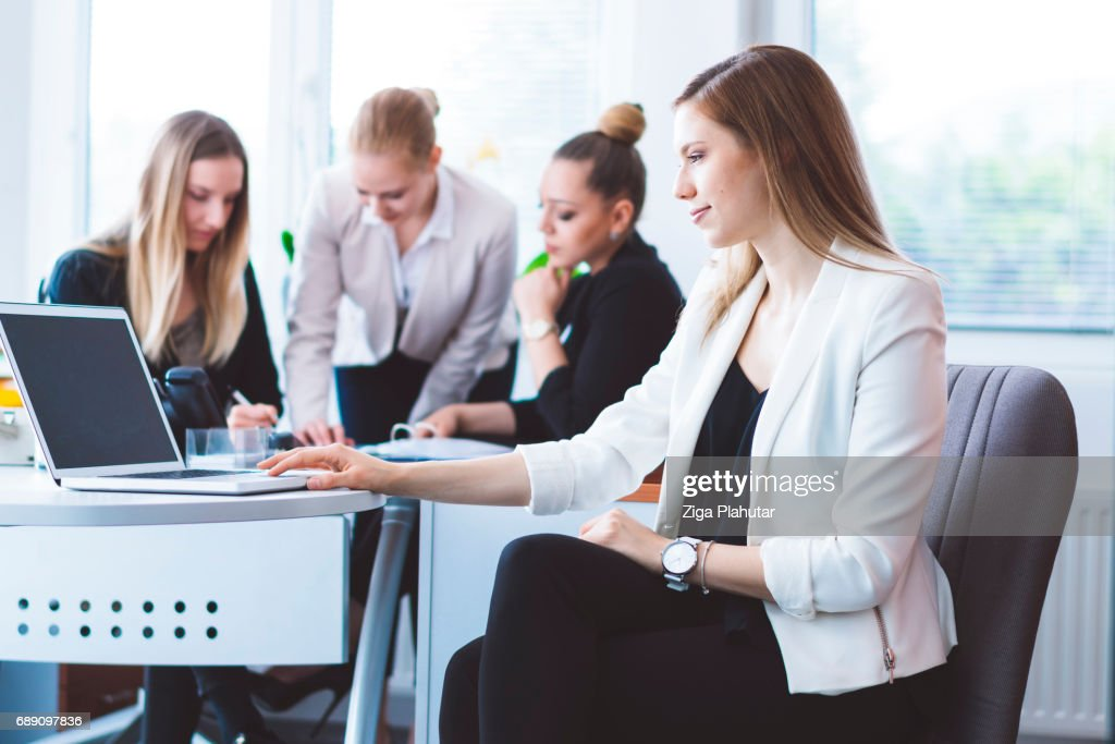 Young CEO on the meeting with her employees : Stock Photo
