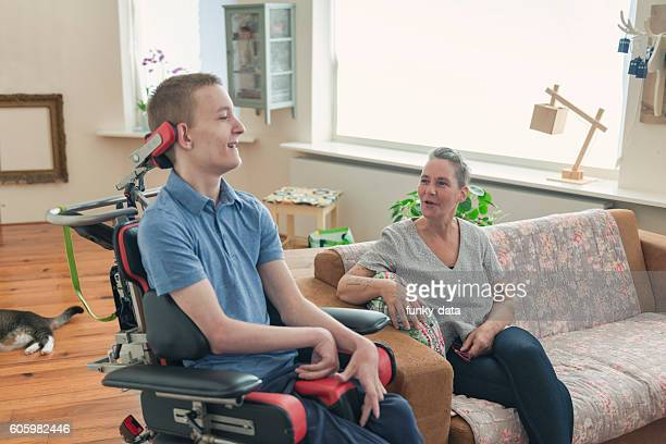 young cerebral palsy patient - paraplegic stock photos and pictures