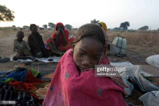 A young Chadian village women shelters under trees after fleeing an attack on her village on November 9 2006 in a camp for internally displaced...