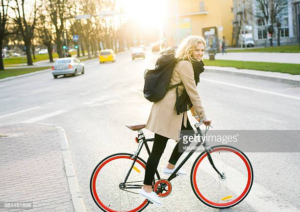 Young Cheerful Commuter Going Home With Bicycle In The Evening