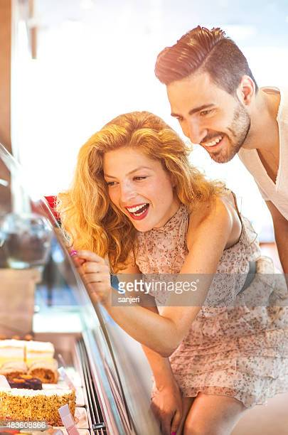 Young cheerful couple buying sweets
