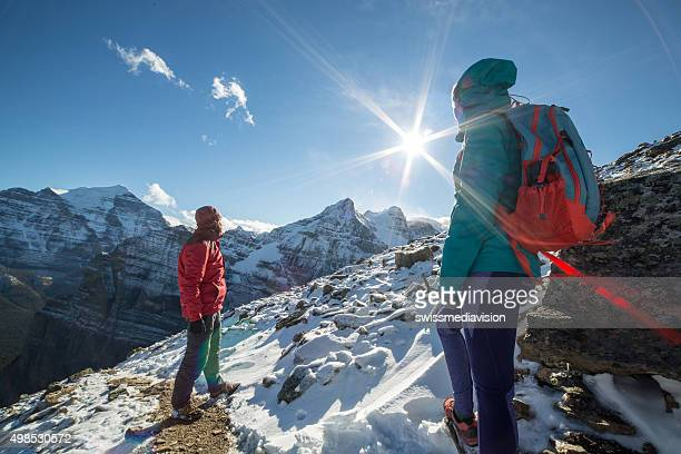 Young cheerful couple hiking on rocky mountains