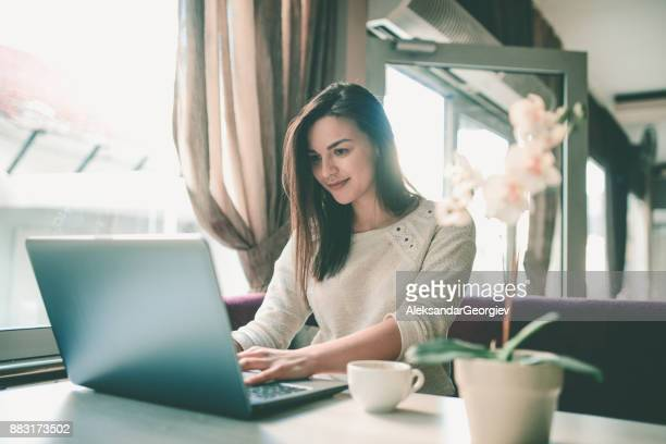 Young Cheerful Female Working on Computer at Home