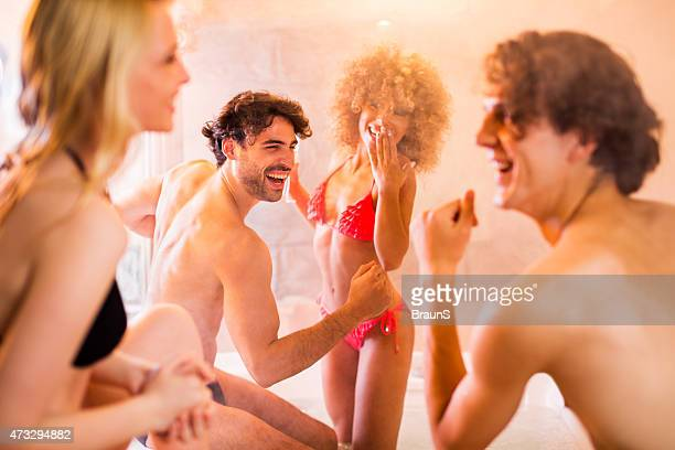Young cheerful people having fun in hot tub.
