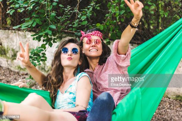 Young cheerful women in a hammock