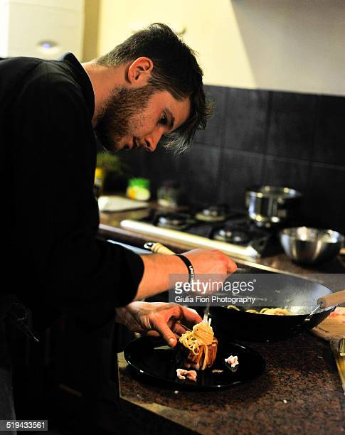 Young chef cooking in a kitchen