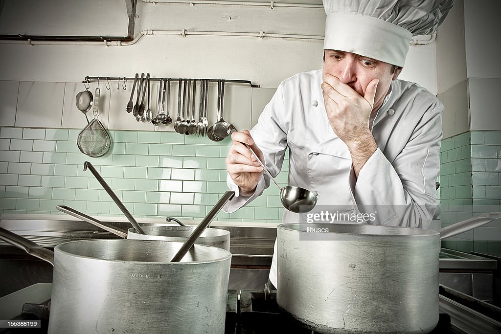 Young chef tasting soup : Stock Photo