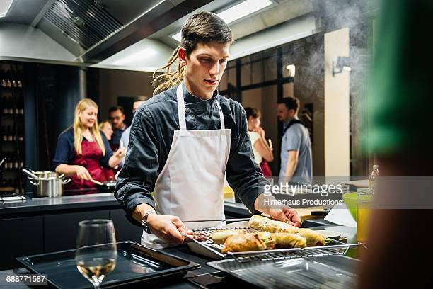 Young Chef with hot food in a cooking class