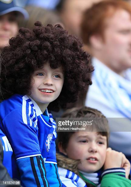 A young Chelsea fan shows his colours during the FA Cup sixth round match between Chelsea and Leicester City at Stamford Bridge on March 18 2012 in...