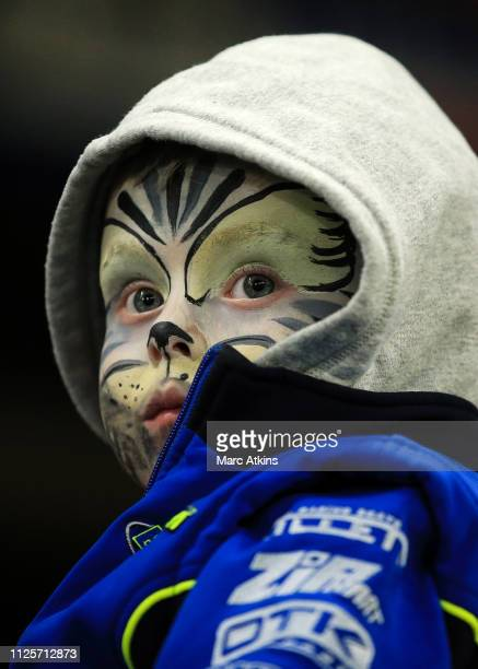 A young Chelsea fan with painted face looks on during the FA Cup Fifth Round match between Chelsea and Manchester United at Stamford Bridge on...