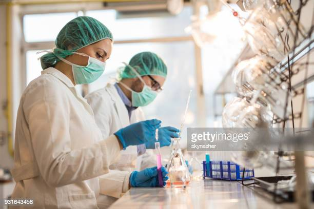 young chemists working on chemical substances in a laboratory. - place of research stock pictures, royalty-free photos & images
