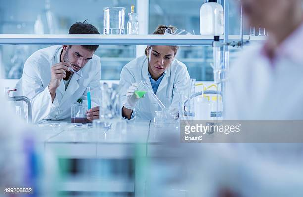 Young chemists working on scientific research in a laboratory.