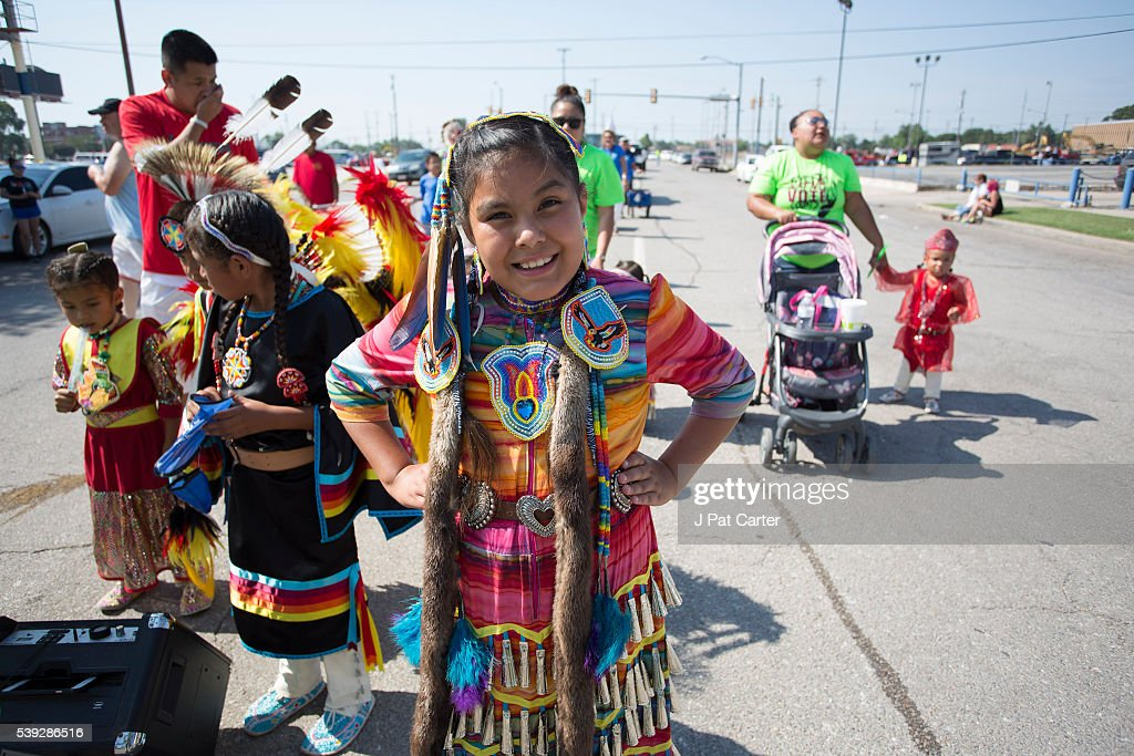 Young Cheyenne/ Arapaho dancers wait for the start of the Red Earth Native American Festival parade, Friday, June 10, 2016 in Oklahoma City.