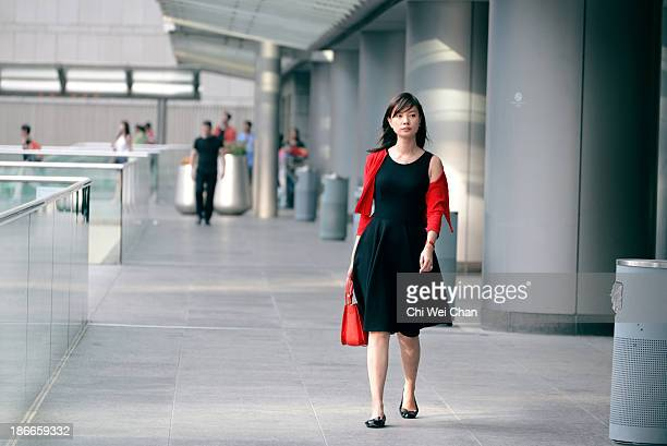 CONTENT] A young chic and elegant lady dresses up on a Saturday afternoon at the IFC a prominent shopping mall in Hong Kong Was she going for...