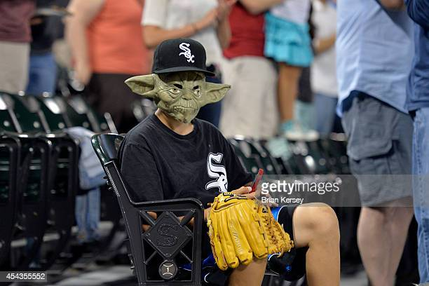 A young Chicago White Sox fan wears a Yoda mask on 'Star Wars Night' during the third inning against the Detroit Tigers at US Cellular Field on...