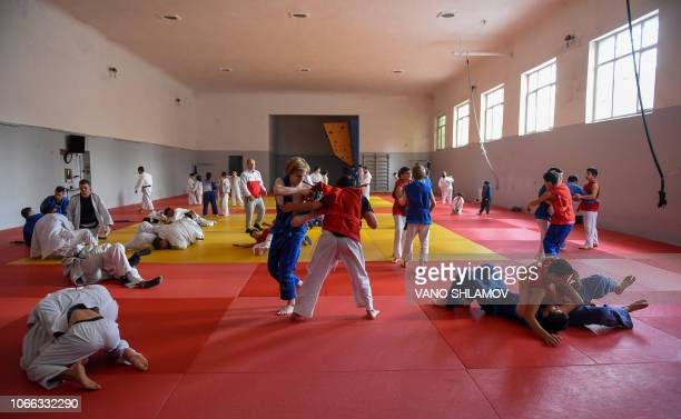Young Chidaoba wrestlers train ia a sports hall in Tbilisi on November 25, 2018. - United Nations culture agency, UNESCO, on November 29 inscribed...