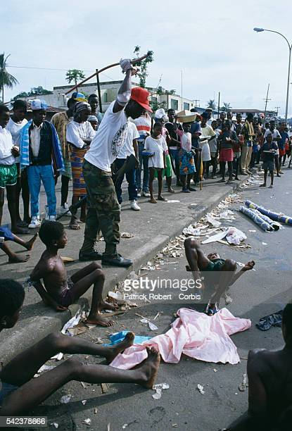 A young child accused of stealing is beaten in the streets of Monrovia by a member of the Independent National Patriotic Front of Liberia Responding...