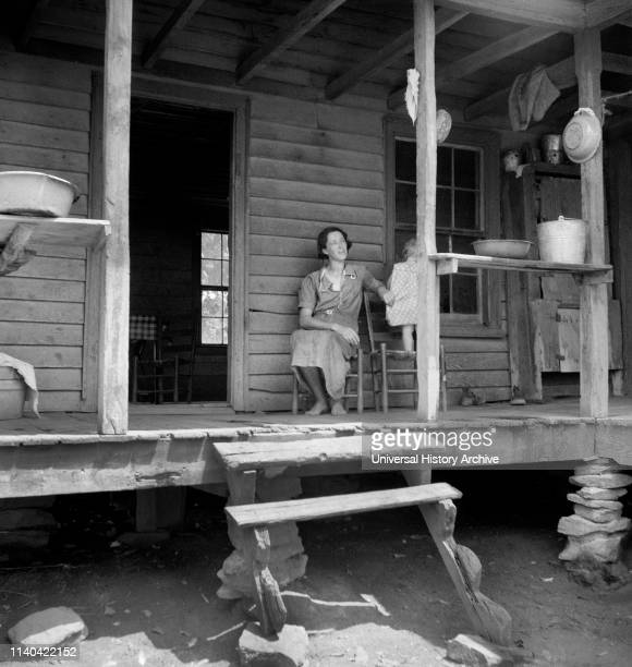 Young Child and Wife of Sharecropper on Rural Porch, Chesnee, South Carolina, USA, Dorothea Lange, Farm Security Administration, June 1937.