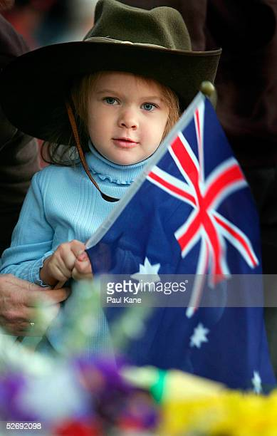 A young child attends the Kings Park dawn service for Anzac Day April 25 2005 in Perth Australia Australians and New Zealanders are today...