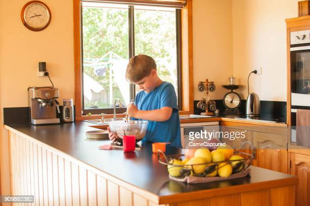 Young Child Baking in Middle Class Kitchen