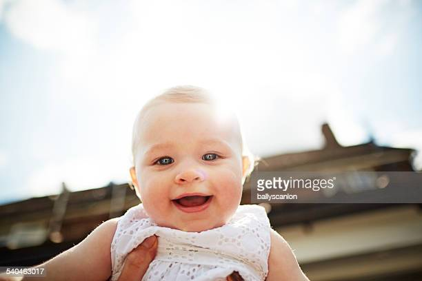 young child being held in the air. - one baby girl only stock pictures, royalty-free photos & images