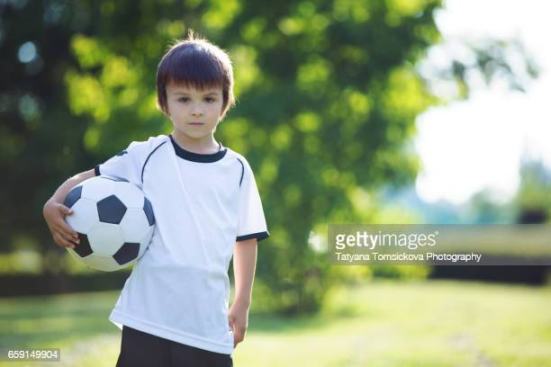 Young Child, boy, playing soccer, player football