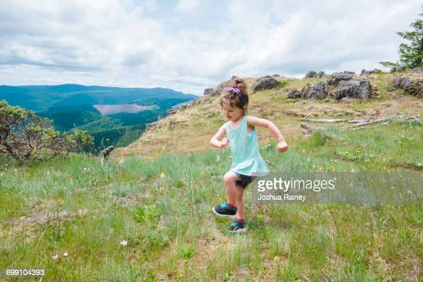 Young child dancing at the top of the Horse Rock Ridge Trail near Eugene Oregon.