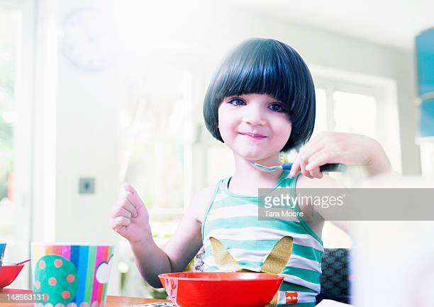 young child eating breakfast