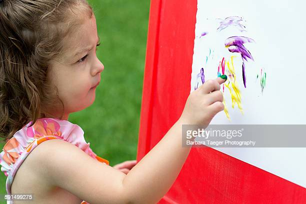 Young child fingerpainting