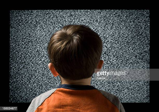 Young Child From Behind  Watching Static Television Screen